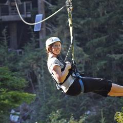 Sara flying over Fitzsimmons Creek on a zipline near Whistler